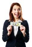 Mulher de negócios de riso que guarda dólares americanos Fotografia de Stock