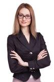 A mulher de negócios de sorriso com braço dobrou os vidros vestindo isolados Imagem de Stock