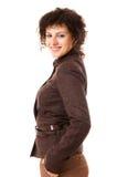 Mulher de negócios do smiley no revestimento marrom Foto de Stock Royalty Free