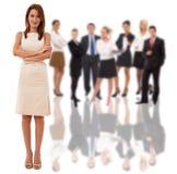Mulher de negócios e sua equipe Imagens de Stock