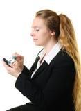 Mulher de negócios e um smartphone imagens de stock royalty free