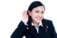A mulher de negócios feliz com ela cede uma orelha fotografia de stock