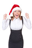 Mulher de negócios feliz em shouting do chapéu de Santa da alegria Foto de Stock
