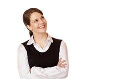 A mulher de negócios feliz nova olha acima no canto Fotografia de Stock Royalty Free