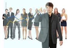 Mulher de negócios feliz nova que aponta o crescimento no gráfico Imagem de Stock Royalty Free