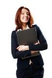 Mulher de negócios feliz que guarda o portátil fotos de stock