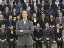 Mulher de negócios In Front Of Multiethnic Executives imagem de stock royalty free