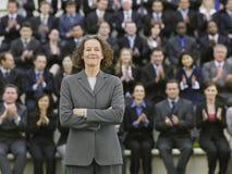 Mulher de negócios In Front Of Multiethnic Executives fotografia de stock royalty free