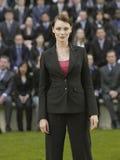 Mulher de negócios In Front Of Multiethnic Executives imagens de stock royalty free