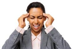 Mulher de negócios frustrante Suffering From Headache imagens de stock royalty free