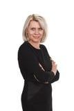 Mulher de negócios madura que está com os braços cruzados contra foto de stock royalty free