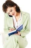 Mulher de negócios na luz - terno verde Imagens de Stock Royalty Free