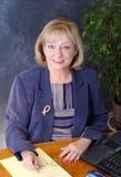 Mulher de negócios na mesa Foto de Stock