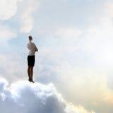 Mulher de negócios no céu Fotografia de Stock