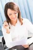 Mulher de negócios no escritório Imagens de Stock