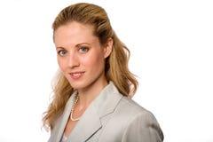 Mulher de negócios no terno cinzento Fotografia de Stock Royalty Free