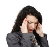 Mulher de negócios nova com dor de cabeça Fotos de Stock