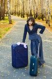 Mulher de negócios nova com mala de viagem. Foto de Stock Royalty Free