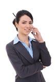 Mulher de negócios nova com telefone Foto de Stock Royalty Free