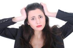Mulher de negócios nova com uma dor de cabeça Fotografia de Stock