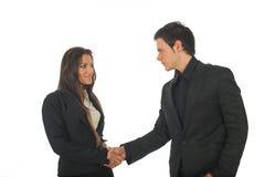 Mulher de negócios nova e homem de negócios que agitam as mãos Imagem de Stock