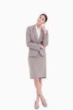Mulher de negócios nova nos pensamentos Foto de Stock Royalty Free