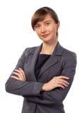 A mulher de negócios ou o professor de sorriso bonito com braço dobraram-se isolado Fotografia de Stock