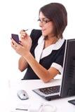 Mulher de negócios que aplica o batom Foto de Stock Royalty Free