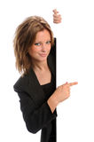 Mulher de negócios que aponta ao sinal em branco Imagens de Stock Royalty Free