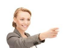 Mulher de negócios que aponta seu dedo Foto de Stock Royalty Free