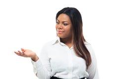 Mulher de negócios que apresenta o espaço da cópia em sua palma Fotos de Stock Royalty Free