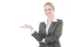 Mulher de negócios que apresenta um produto fotografia de stock royalty free