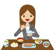 Mulher de negócios que come o café da manhã do japonês ilustração royalty free
