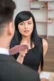 Mulher de negócios que flerta e que puxa seu colega Fotografia de Stock Royalty Free