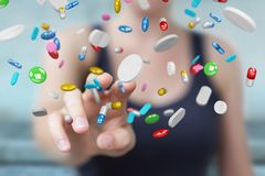 Mulher de negócios que guarda e que toca nos comprimidos de flutuação 3D da medicina com referência a Fotos de Stock Royalty Free