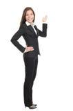 Mulher de negócios que mostra o espaço da cópia Fotos de Stock Royalty Free