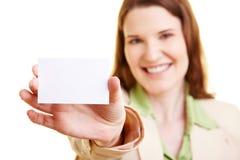 Mulher de negócios que mostra seus businss Foto de Stock Royalty Free
