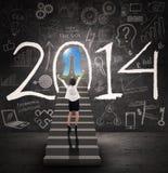 Mulher de negócios que obtém o sucesso no ano novo 2014 Fotografia de Stock