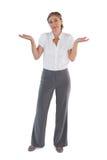 Mulher de negócios que olha de questão fotografia de stock royalty free