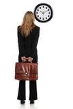 Mulher de negócios que olha um pulso de disparo do dólar Fotos de Stock Royalty Free