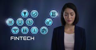 Mulher de negócios que pensa Fintech com vários ícones do negócio Imagens de Stock