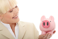 Mulher de negócios que prende o banco piggy Imagem de Stock