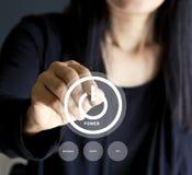 Mulher de negócios que pressiona botões do negócio do poder, conceito do negócio Fotografia de Stock