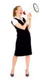 Mulher de negócios que Shouting através do megafone Fotos de Stock