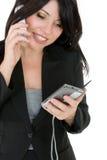 Mulher de negócios que telefona a um cliente imagem de stock royalty free