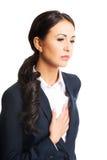 Mulher de negócios que tem a doença cardíaca Foto de Stock