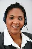 Mulher de negócios que toma atendimentos Fotografia de Stock Royalty Free