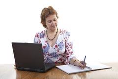 Mulher de negócios que toma notas Foto de Stock