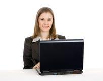 Mulher de negócios que trabalha no portátil.   Foto de Stock Royalty Free