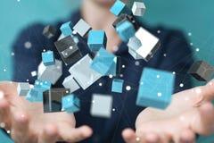Mulher de negócios que usa o renderin brilhante azul de flutuação da rede 3D do cubo Imagem de Stock Royalty Free